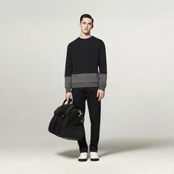 French Terry Sweatshirt in Navy/Grey, $29.99; Pant in Navy, $39.99; Valise in Black, $59.99; High Top Sneaker in White, $44.99