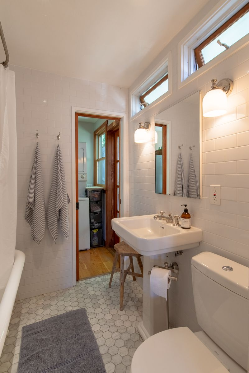 Bathroom with white tiles.