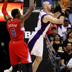 Phoenix Suns' Marcin Gortat, of Poland, passes around Los Angeles Clippers' DeAndre Jordan (6) during the first half of an NBA basketball game, Thursday, April 19, 2012, in Phoenix.