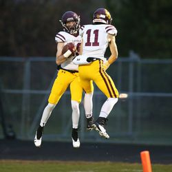 Loyola's Rory Boos, left, and Artie Collins celebrate after Boos' touchdown.  Allen Cunningham/For the Sun-Times.