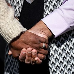 Darlene McDonald, left, and Kamaal Ahmad, right, both members of Salt Lake City's Commission on Racial Equity in Policing, hold hands during a press conference at the International Peace Gardens in Salt Lake City on Tuesday, April 20, 2021. The group gathered to share their reaction to the guilty verdicts returned in the trial of former police officer Derek Chauvin in Minneapolis.
