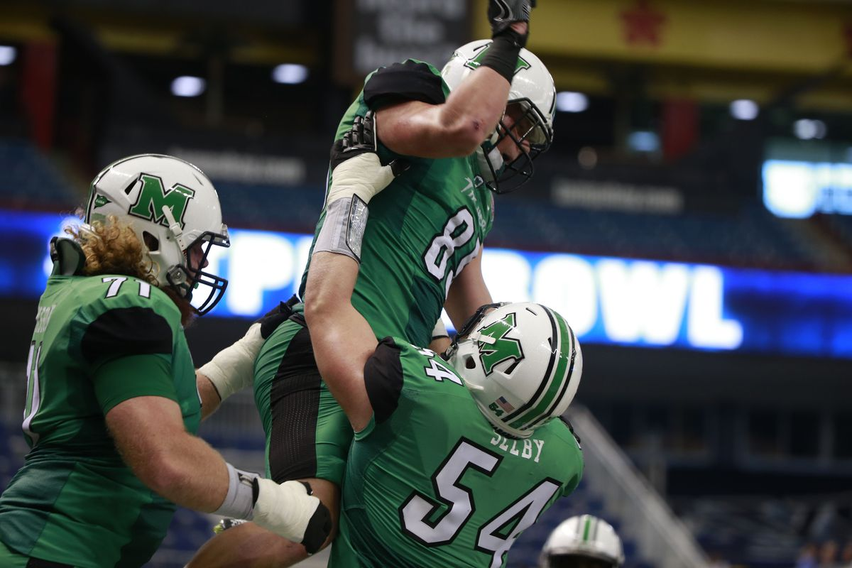 Marshall's Ryan Yurachek (85) celebrates with Michael Selby (54) after scoring a touchdown in St. Pete.