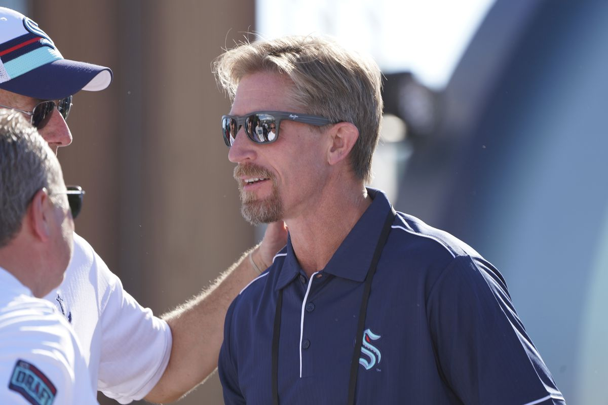 Seattle head coach Dave Hakstol talks with some members of the Kraken staff during the NHL-Seattle Kraken expansion draft July 21, 2021 at Gas Works Park in Seattle, WA.
