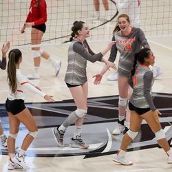 Skyridge celebrates a point against Mountain Ridge in a girls volleyball match in Herriman on Tuesday, Sept. 7, 2021.