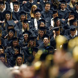 Students listen to the speakers during Spring Commencement Exercises at BYU Thursday, April 19, 2012 at the Marriott Center.