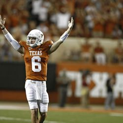 Backup quarterback Case McCoy #6 of the Texas Longhorns signals victory over BYU Cougars as time runs out on September 10, 2011 at Darrell K. Royal-Texas Memorial Stadium in Austin, Texas. Texas defeated BYU 17-16.  (Photo by Erich Schlegel/Getty Images)