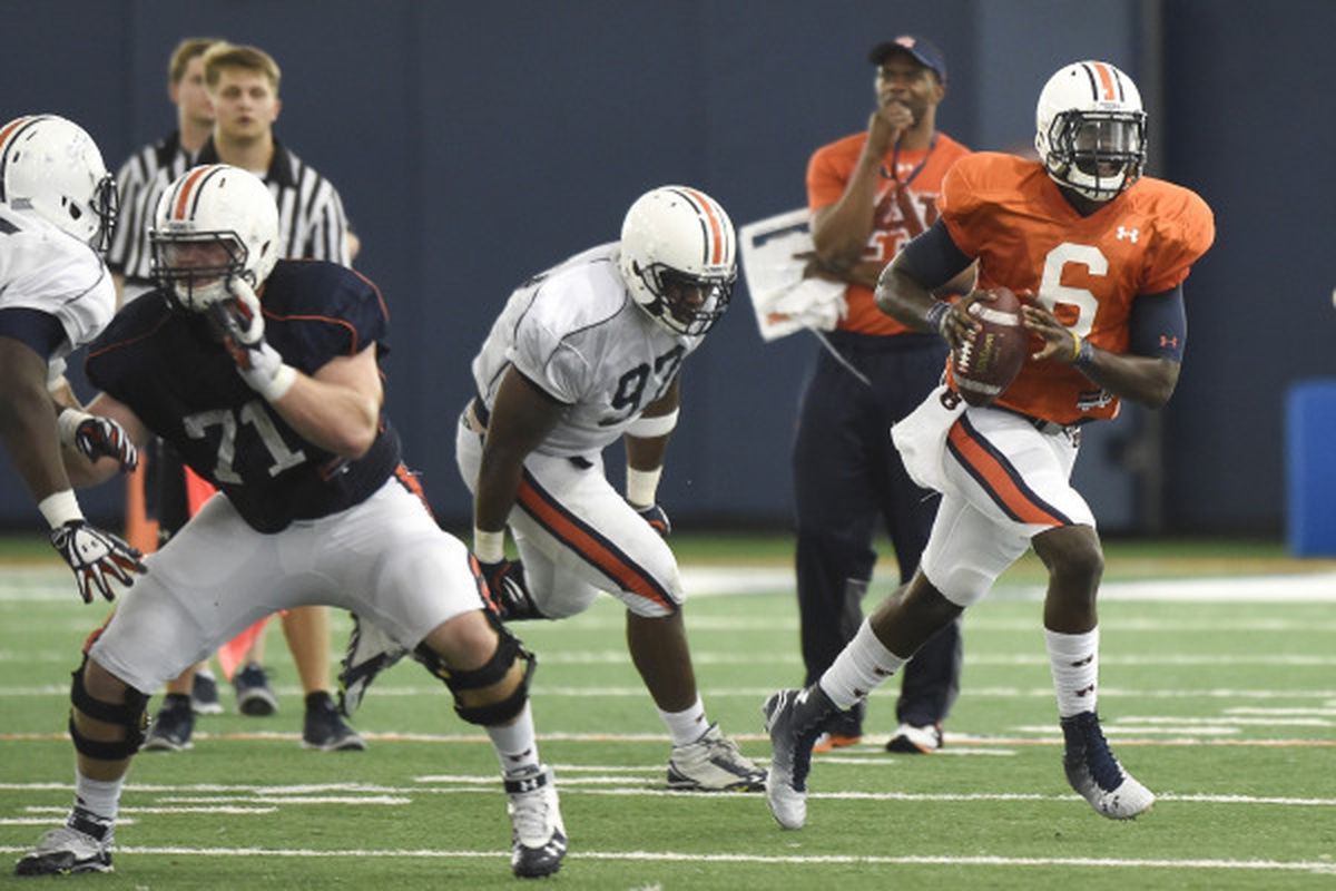 Jeremy Johnson rolls out during the March 31st practice.