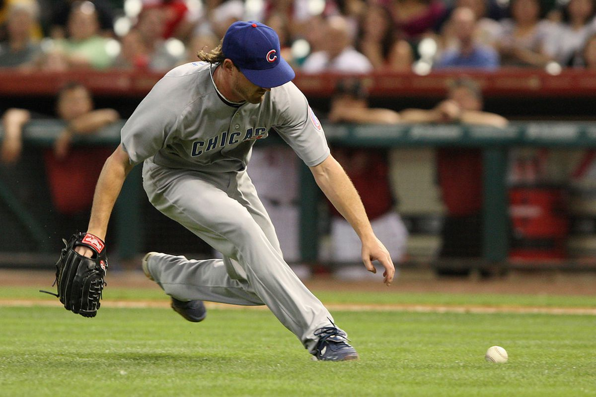May 22, 2012; Houston, TX, USA; Chicago Cubs starting pitcher Travis Wood (30) fields a ground ball in the third inning against the Houston Astros at Minute Maid Park. Mandatory Credit: Troy Taormina-US PRESSWIRE