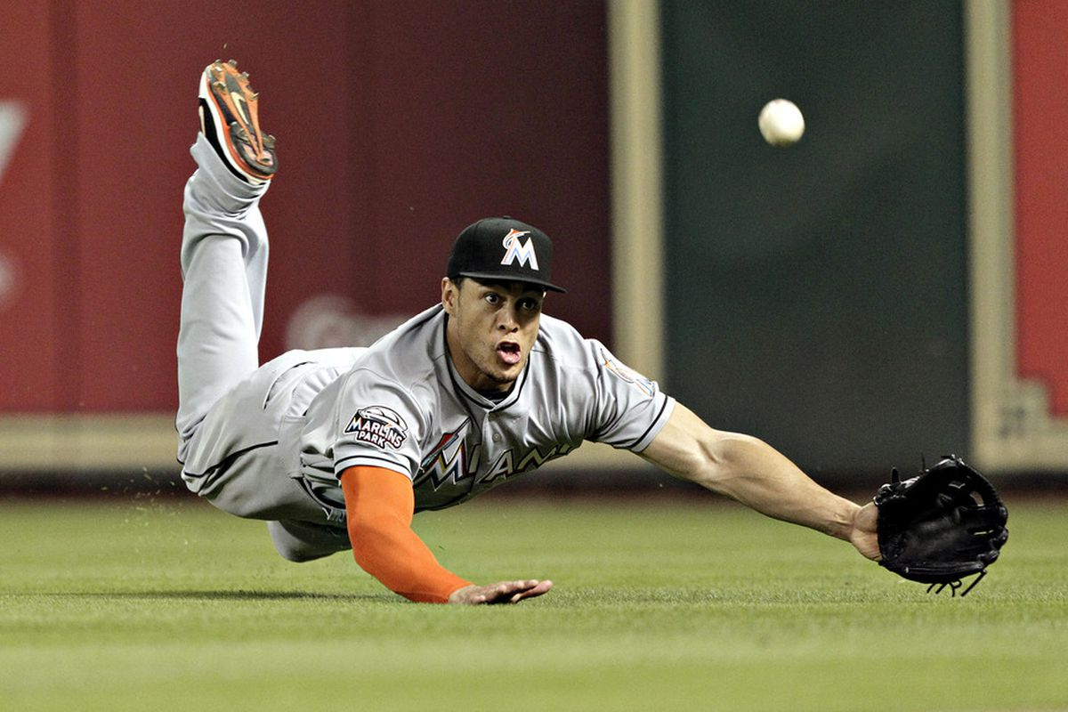 HOUSTON,TX-MAY 09 : Giancarlo Stanton naturally makes a duck face when diving for a ball to appeal to the teenage female audience. Is their anything this guy can't do? (Photo by Bob Levey/Getty Images)
