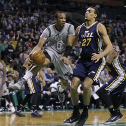 Boston Celtics guard Avery Bradley (0) looks to pass the ball against the defense of Utah Jazz center Rudy Gobert (27) during the second half of an NBA basketball game in Boston, Wednesday, March 4, 2015. The Celtics won 85-84. (AP Photo/Elise Amendola)