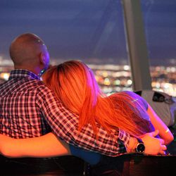 People enjoy the view from the Observation Deck at the Stratosphere in Las Vegas on Thursday, April 5, 2012.