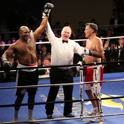 Five-time heavyweight champion Evander Holyfield wins a fight against former Massachusetts Gov. Mitt Romney at Charity Vision Fight Night at The Rail Event Center in Salt Lake City on Friday, May 15, 2015.