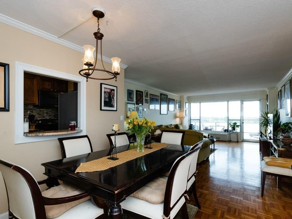 A long open living room and dining room with furniture.