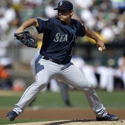 Seattle Mariners' Jason Vargas works against the Oakland Athletics in the first inning of a baseball game Saturday, Sept. 29, 2012, in Oakland, Calif.