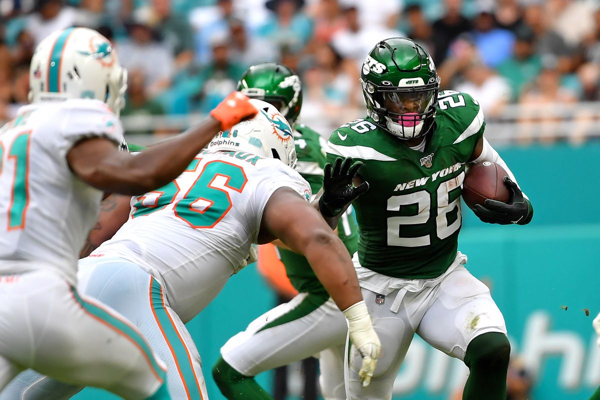 New York Jets running back Le'Veon Bell carries the ball against the Miami Dolphins during the first half at Hard Rock Stadium.