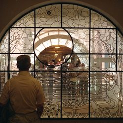 Winston Hickman of Springville looks at a stained glass piece entitled Passages of Light inside the Provo Library during grand opening ceremonies for the newly-renovated Academy Square Saturday, Sept. 8, 2001.