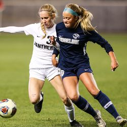 Ridgeline's Brenli Wolford (20) tackles Pine View's Brynlee Johnston (39) during a 4A high school girls soccer semifinal at Rio Tinto Stadium in Sandy on Thursday, Oct. 22, 2020.