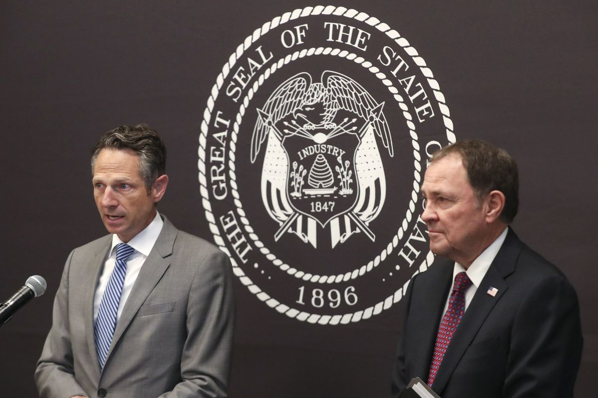 Derek Miller, Economic Response Task Force Chairman, left, and Gov. Gary Herbert address the evolving economic situation associated with COVID-19, including community response and best practices for businesses and consumers during a press conference at the Capitol in Salt Lake City on Friday, March 20, 2020.