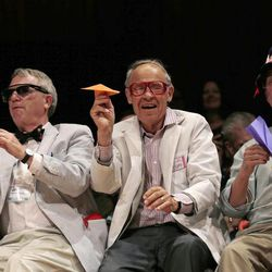 CORRECTS TO REFLECT THAT KIRSHNER IS NOT A NOBEL LAUREATE, ADDS HIS CURRENT TITLE - Harvard University Clowes Professor of Science Robert Kirshner, left, along with Nobel laureates Dudley Herschbach, center, and Rich Roberts, fire paper airplanes back at the audience during a performance at the Ig Nobel Prize ceremony at Harvard University, in Cambridge, Mass., Thursday, Sept. 20, 2012. The Ig Nobel prize is an award handed out by the Annals of Improbable Research magazine for silly sounding scientific discoveries that often have surprisingly practical applications.