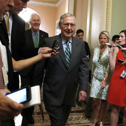 Senate Majority Leader Mitch McConnell of Ky., center, followed by Majority Whip John Cornyn, R-Texas, leaves a Republican meeting on healthcare, Thursday, June 22, 2017, on Capitol Hill in Washington. Senate Republicans would cut Medicaid, end penalties for people not buying insurance and erase a raft of tax increases as part of their long-awaited plan to scuttle Barack Obama's health care law.