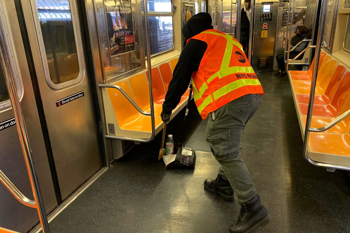 A subway car cleaner on the 3 train at the 148 Street station, May 3, 2021.