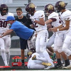 Action in the Maple Mountain at Pleasant Grove football game in Pleasant Grove on Friday, Aug. 21, 2020.