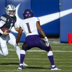 Brigham Young Cougars quarterback Zach Wilson (1) runs the ball as North Alabama Lions defensive back Kyree Fields (1) closes in on him during a game in Provo on Saturday, Nov. 21, 2020.