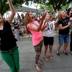 From left, Ashlyn Arrington, Marlee Fowers, Alyssa Arrington, McKenzie Arrington and Lilly Ward dance as Beyond 5 performs at Five-O Fest, a free community festival hosted by the Utah Anti-Bullying Coalition, Safe2Help and the Salt Lake City Police Foundation outside of the Public Safety Building in Salt Lake City on Saturday, May 31, 2014.