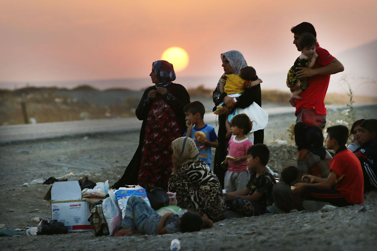 An Iraqi family in 2003 outside of Mosul, displaced by the US-led invasion (Spencer Platt/Getty)