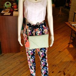 """Again, the skin-baring crop top (Lucca Couture Cut-Out Crop Top, $65) is toned down by a high-waisted bottom (<a href=""""http://aokiboutique.com/shop/paradise-pants-by-numph/"""">Watercolor Paradise Pants</a> by Numph, $80)."""