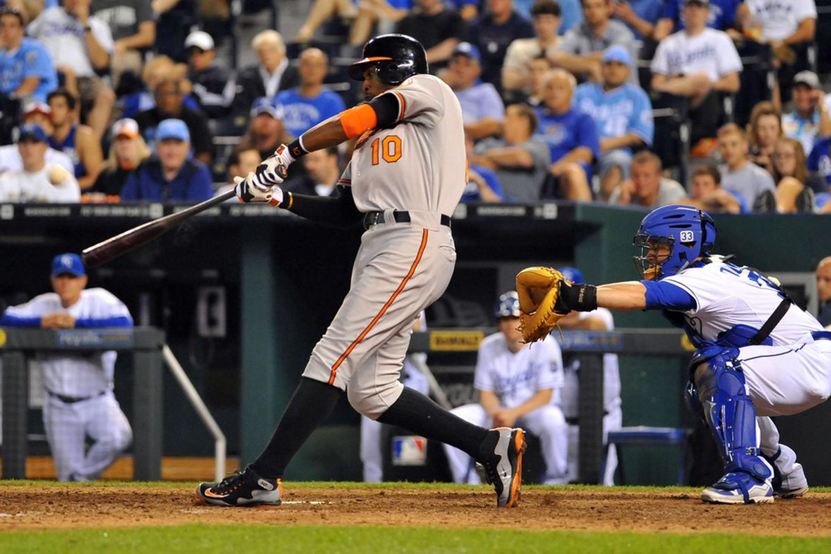 May 16, 2012; Kansas City, MO, USA; Baltimore Orioles center fielder Adam Jones (10) connects for a home run in the 15th inning of the game against the Kansas City Royals at Kauffman Stadium. The Orioles won 4-3.