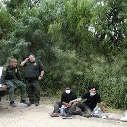 U.S. Border Patrol Agent Hermann Rivera and Supervisory Border Patrol agent and Rio Grande Valley sector chaplain Robert Hess detain undocumented migrants in McAllen, Texas, on Tuesday, June 22, 2021.