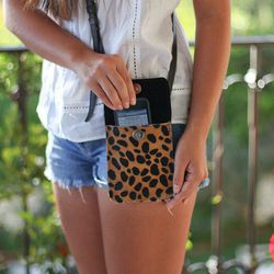 """<a href=""""http://www.etsy.com/listing/116079100/leather-phone-bag""""target=""""_blank"""">MalibuBows</a> (Table #T81)"""