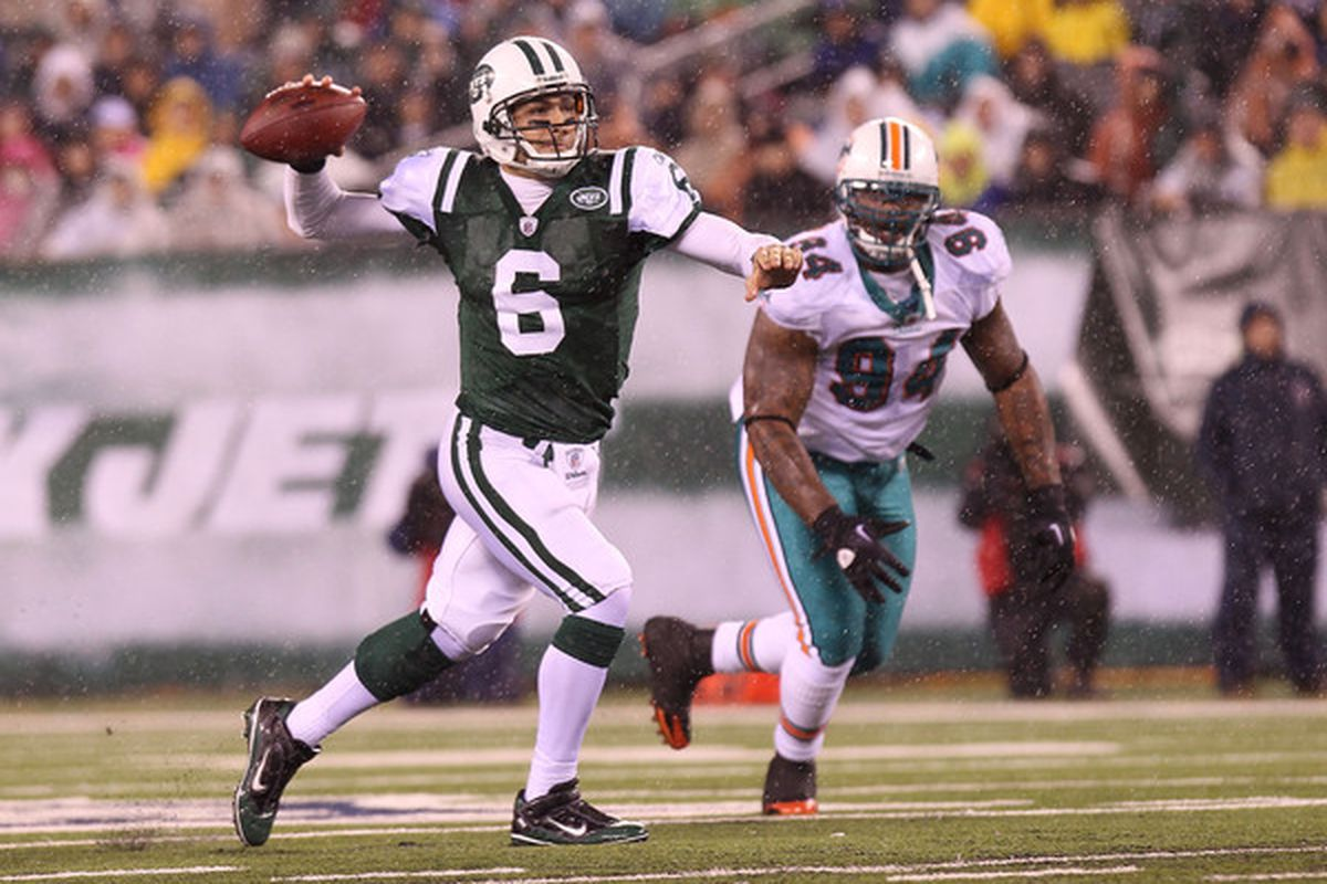EAST RUTHERFORD NJ - DECEMBER 12: Mark Sanchez #6 of the New York Jets opens up to pass against the Miami Dolphins at New Meadowlands Stadium on December 12 2010 in East Rutherford New Jersey.  (Photo by Nick Laham/Getty Images)
