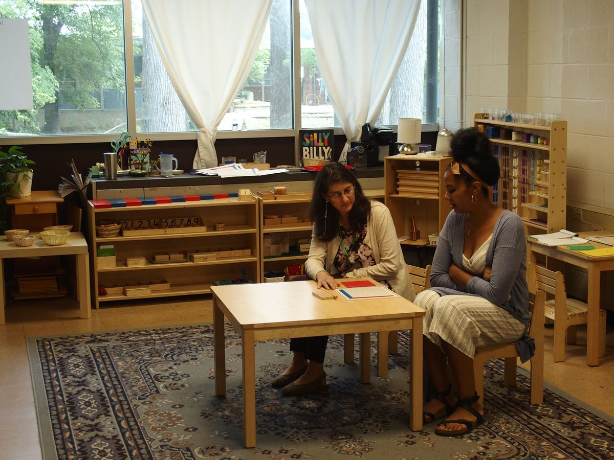 Montessori teachers Dawn Bradley and Veronica Burbano use hands-on learning materials during a summer training session at Libertas School of Memphis.