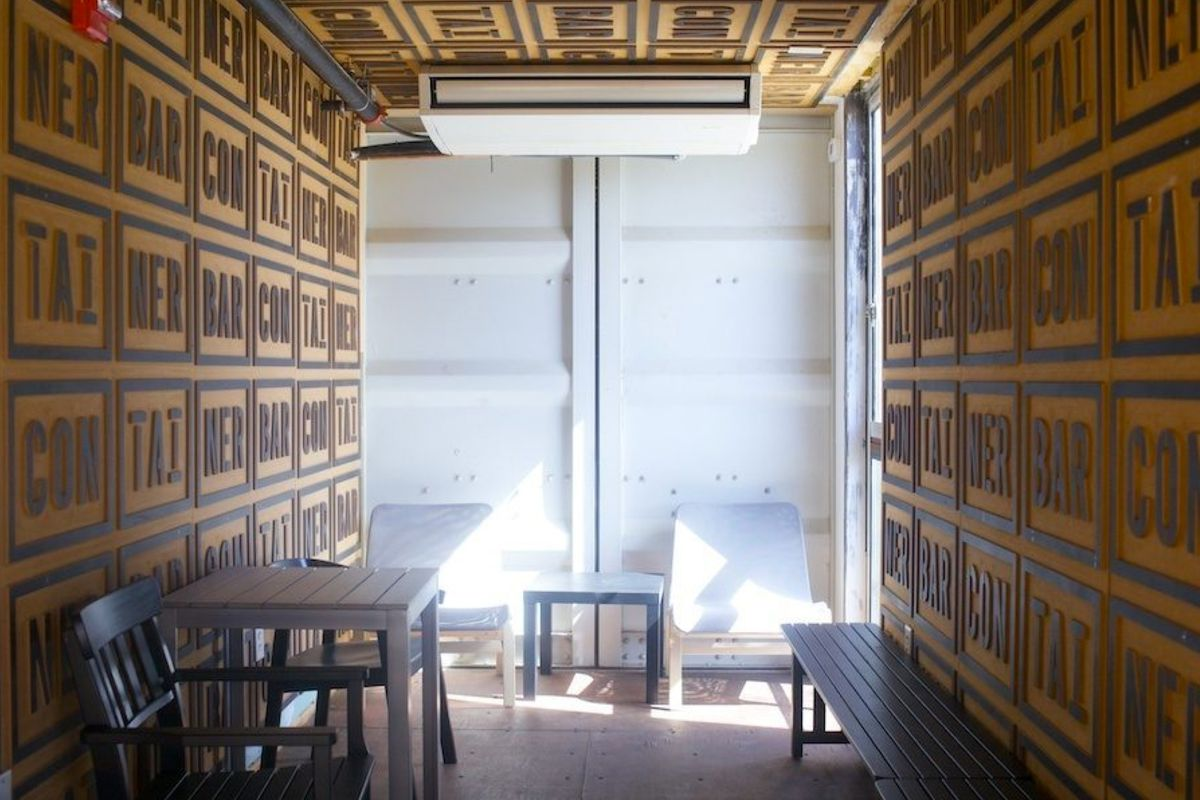 """<a href=""""http://austin.eater.com/archives/2014/03/24/go-inside-container-bars-repurposed-shipping-containers.php"""">Container Bar, Austin, TX</a>"""