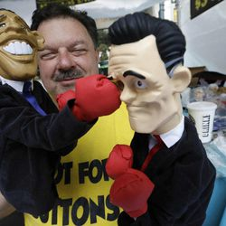 Street Vendor Mark Evans shows off his hand puppets during Carolina Fest, Monday, Sept. 3, 2012, in Charlotte, N.C., before the Democratic National Convention.
