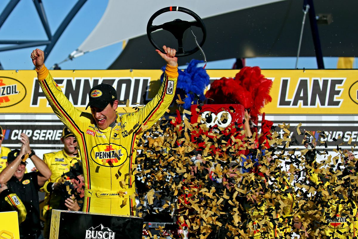 NASCAR Cup Series driver Joey Logano celebrates winning the Pennzoil 400 presented by Jiffy Lube at Las Vegas Motor Speedway.