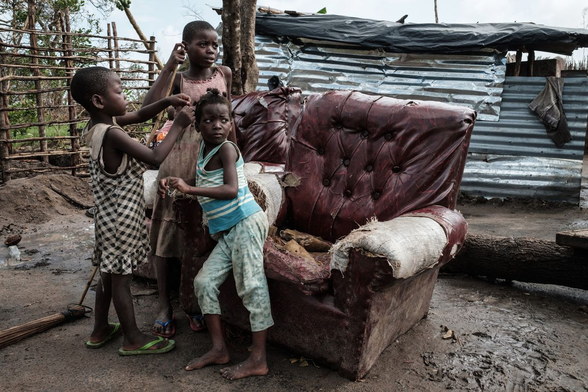 Children play in front of a house destroyed by the winds of cyclone Idai in Beira, Mozambique, on March 27, 2019.