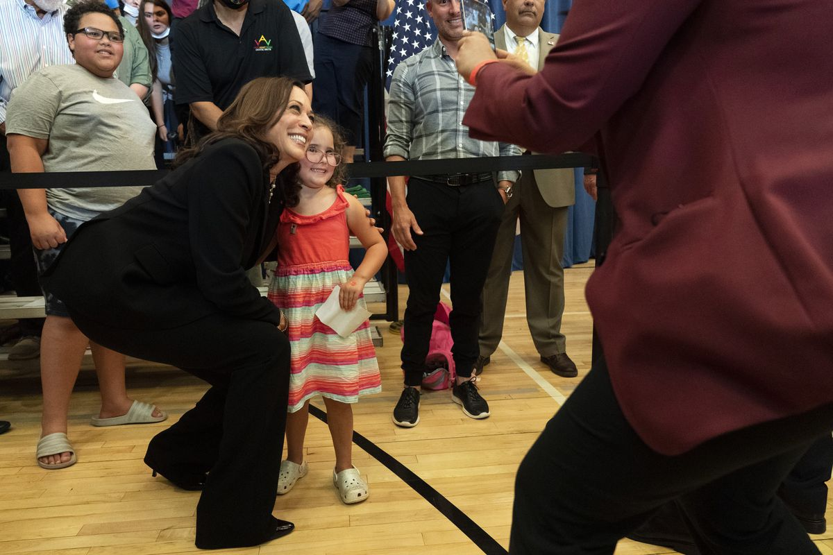 Vice President Kamala Harris leans in for a photograph with Stella Quatrini after Harris spoke about the Child Tax Credit at Brookline Memorial Recreation Center in Pittsburgh on June 21, 2021.