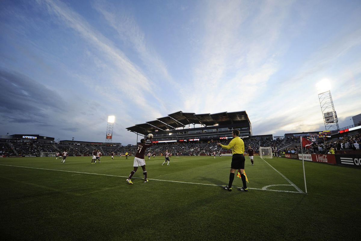 April 28, 2012; Commerce City, CO, USA; Colorado Rapids defender Kosuke Kimura (27) prepares to throw in during the first half against Chivas USA at Dick's Sporting Goods Park. Mandatory Credit: Ron Chenoy-US PRESSWIRE