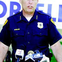 Salt Lake Police Chief Rick Dinse describes the ongoing investigation in August 2002.