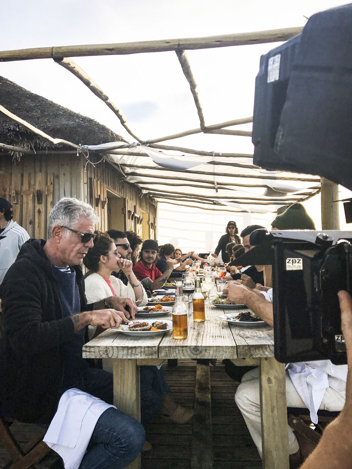 Anthony Bourdain dining at a communal table during this week's episode of Parts Unknown
