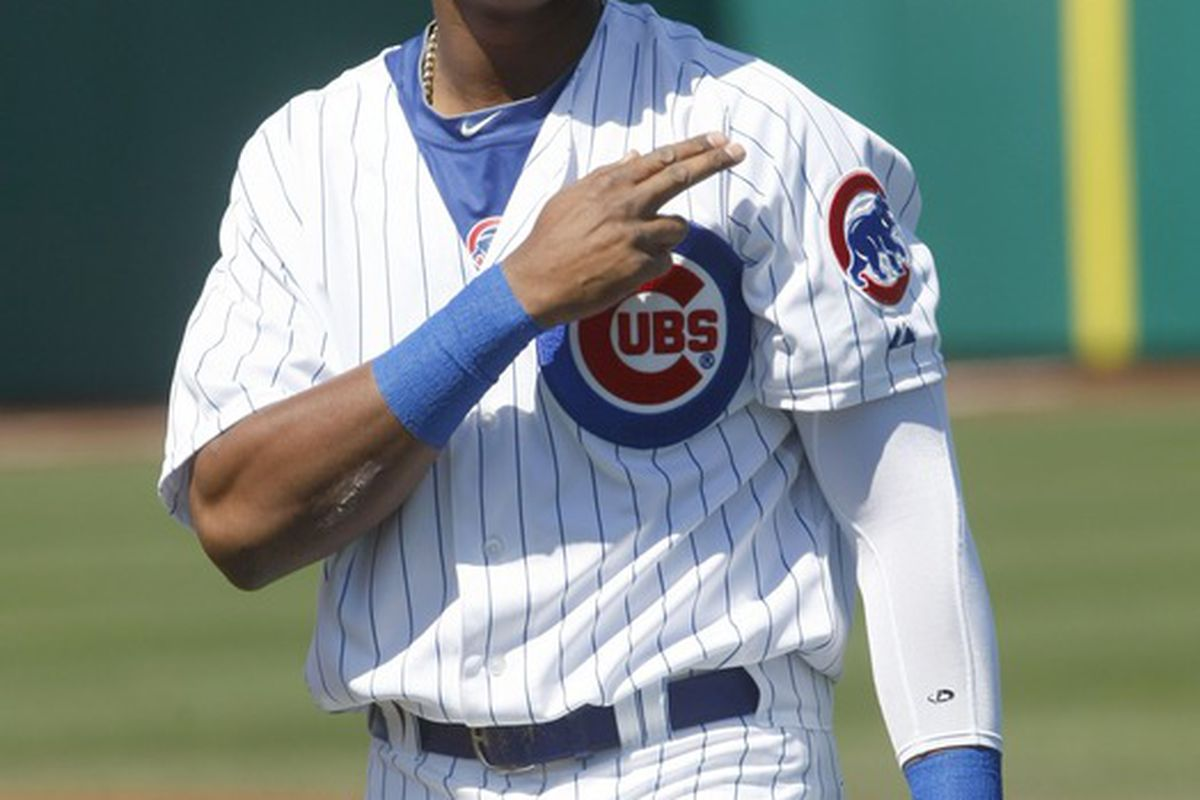 Mesa, AZ, USA; Chicago Cubs shortstop Starlin Castro acknowledges the fans before a game against the Texas Rangers at HoHoKam Park.  Credit: Rick Scuteri-US PRESSWIRE