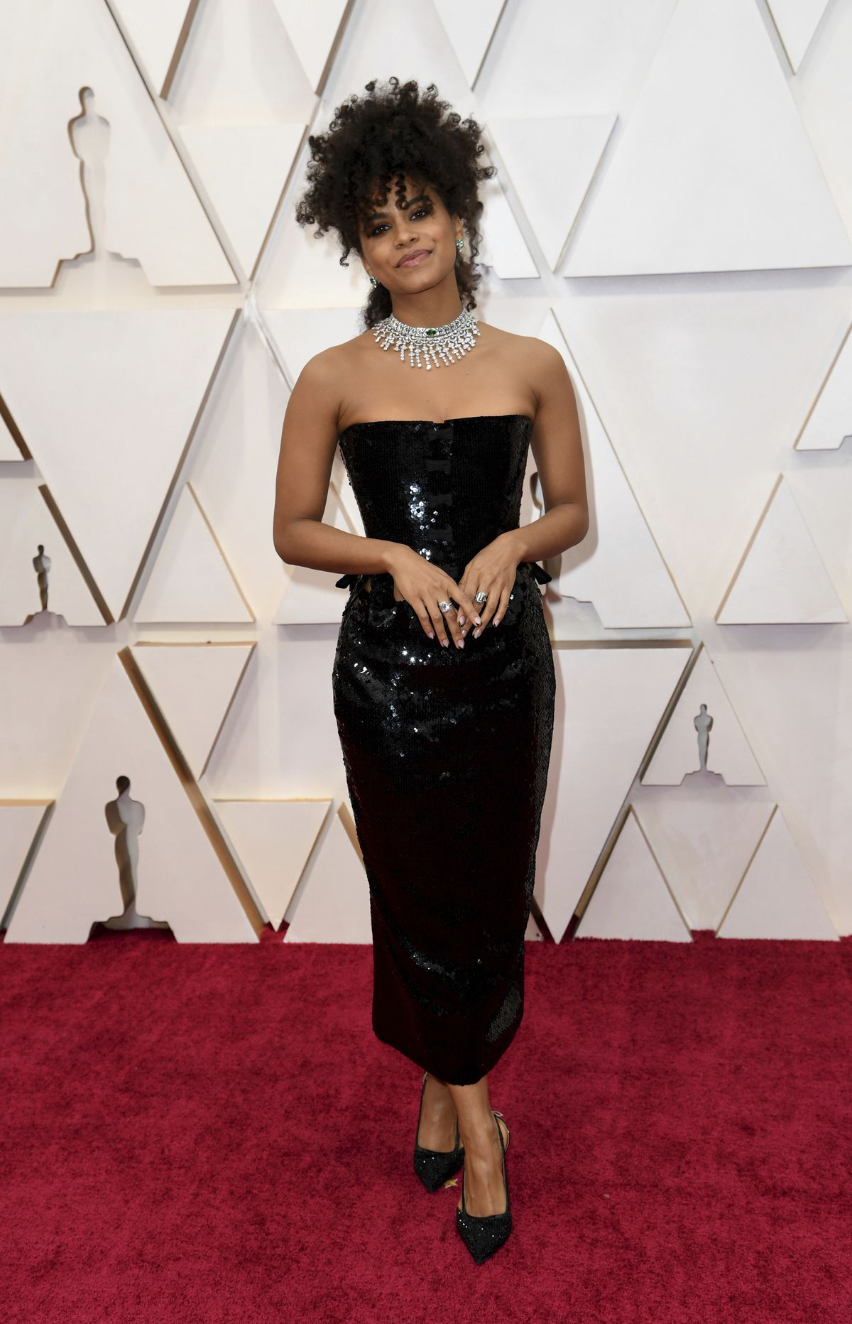 """Zazie Beetz, co-star in the Oscar-nominated """"Joker,"""" arrives at the Oscars on Sunday wearing Tom Ford couture."""