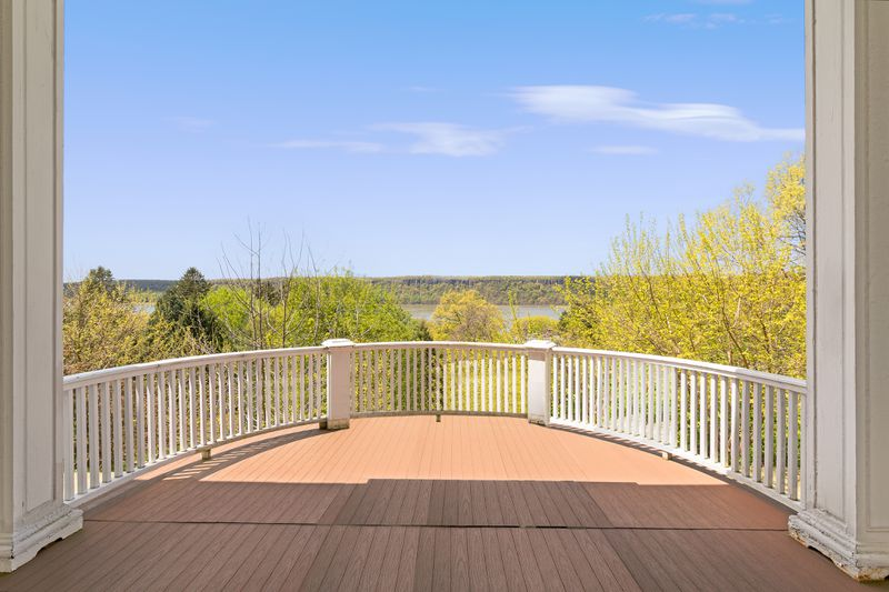 Curved deck with views of a river and foliage.