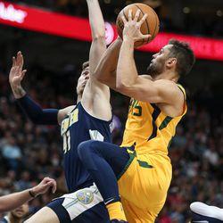Utah Jazz guard Raul Neto (25) lays it up against Denver Nuggets forward Juan Hernangomez (41) at Vivint Smart Home Arena in Salt Lake City on Tuesday, Nov. 28, 2017.