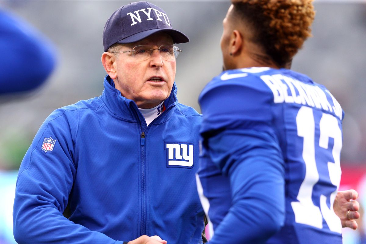 Tom Coughlin shakes hands with Odell Beckham before Sunday's game