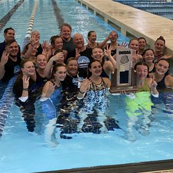 Carbon's girls celebrate winning the 3A state championship at the South Davis Rec Center in Bountiful on Saturday.
