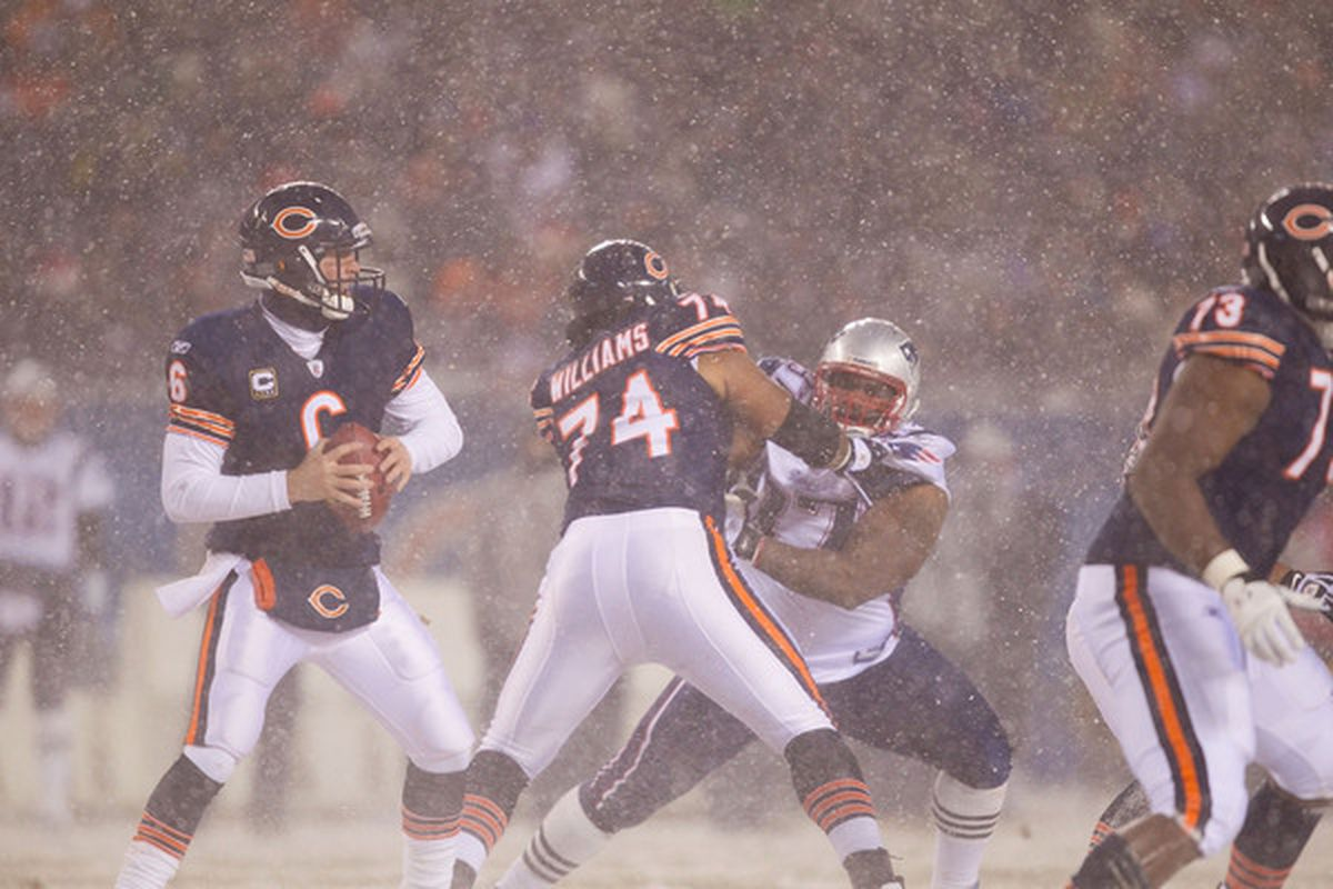 Jay Cutler of the Chicago Bears looks to pass against the New England Patriots at Soldier Field on December 12 2010 in Chicago Illinois.  The Patriots beat the Bears 36-7.  (Photo by Dilip Vishwanat/Getty Images)